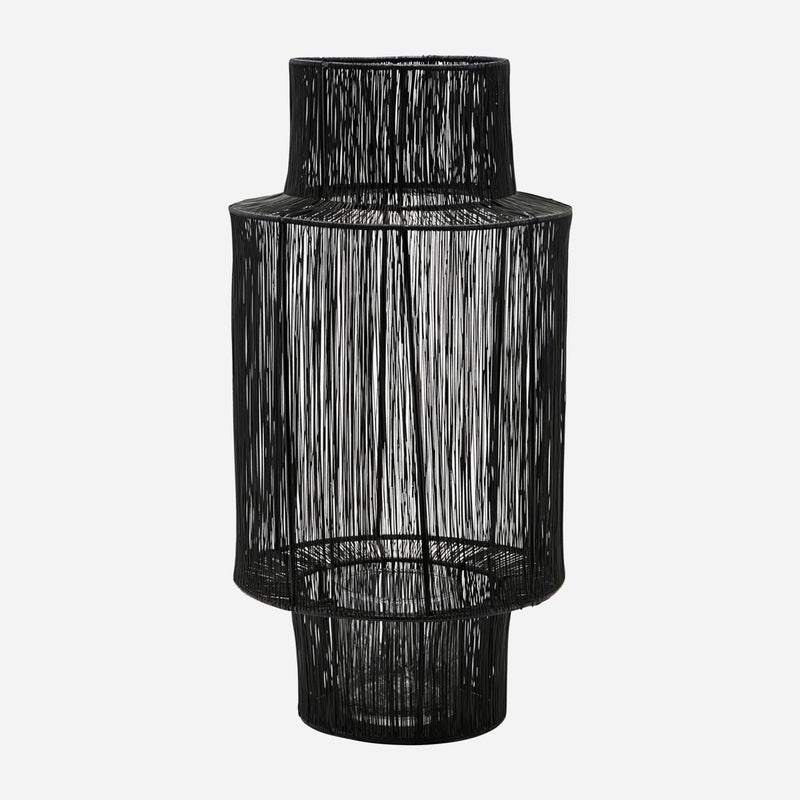 tall dark steel lantern with wide middle by house doctor