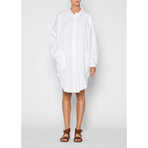 model wearing white button up shirt dress and brown sandals