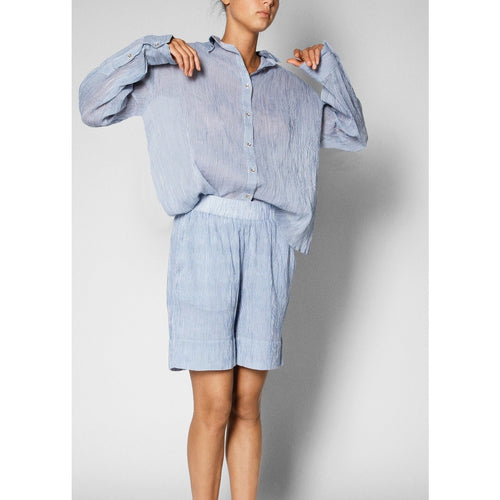blue relaxed button up paired with blue cotton shorts
