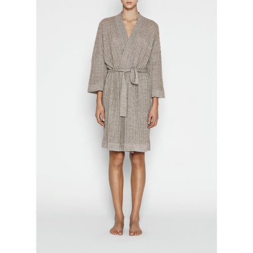 model wearing light beige llama wool knitted bathrobe with belt by designer aiayu