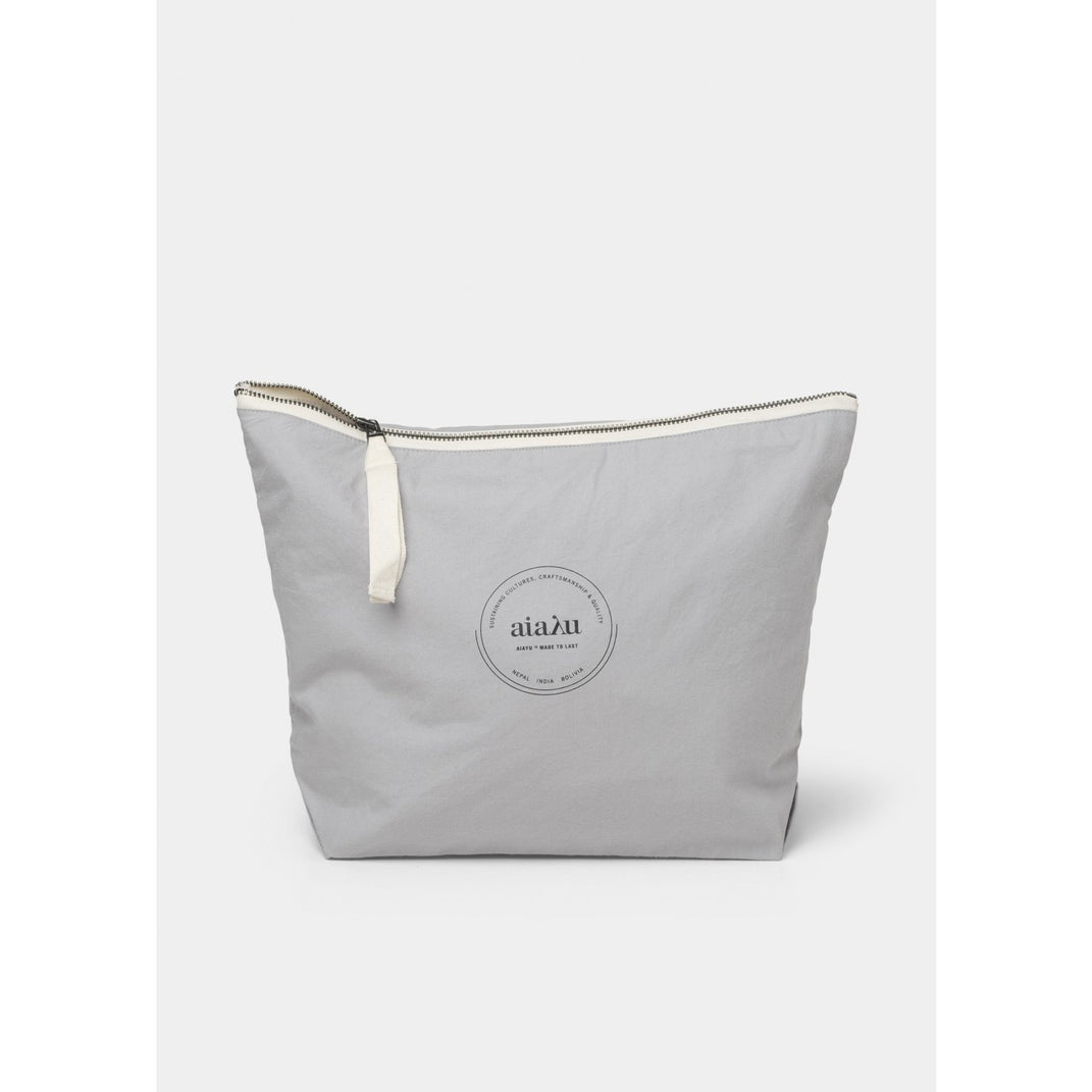 light grey organic cotton pouch with white ribbon zip closure by designer aiayu