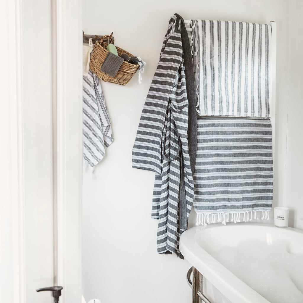 mix of striped towels hanging in a bathroom