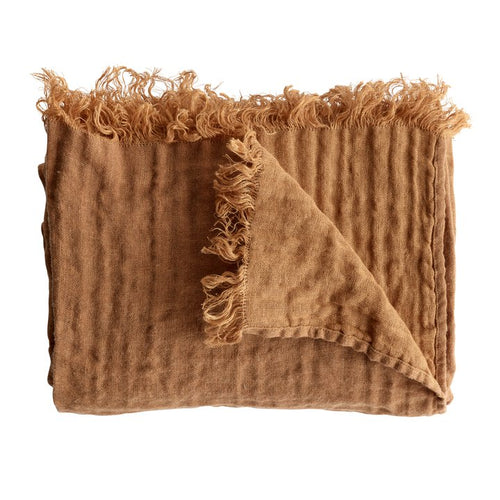 folded wool throw in amber by designer tine k