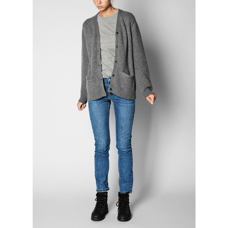 model wearing grey version of the cardigan with a light grey tee and blue jeans and black boots