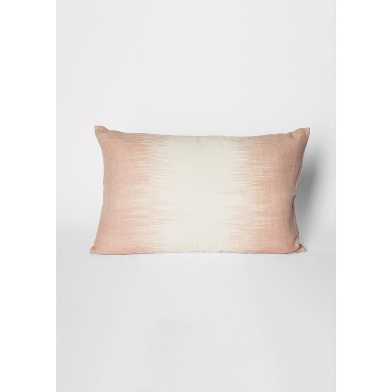light pink pillow with white accent in middle