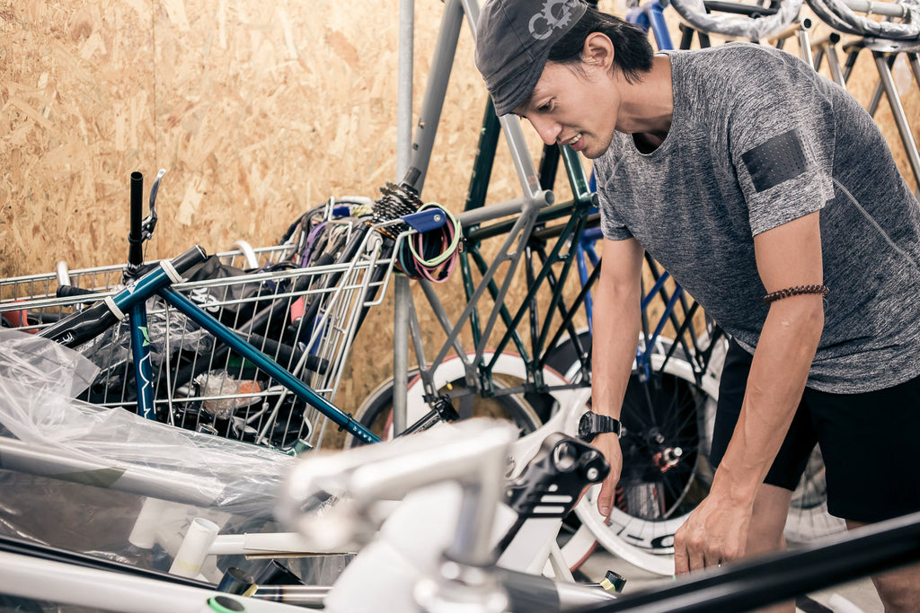 Klamm tinkering with bike parts