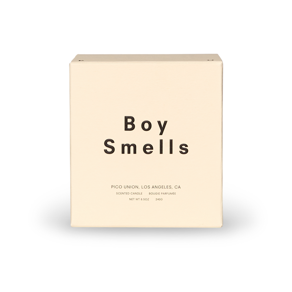 boy smells scented candle