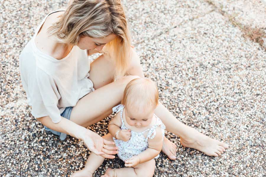 Blonde woman sitting with a baby