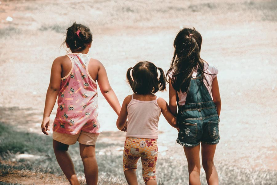 Three little girls standing together