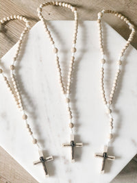 Made of white cord and light wooden beads and a light wood Crucifix