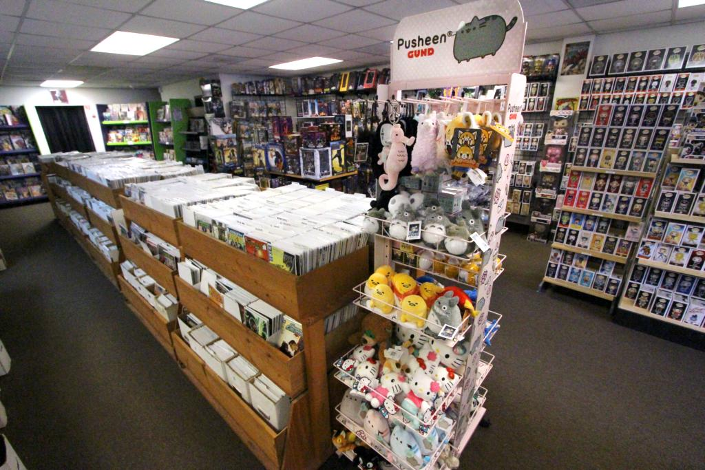 Two displays featuring comic books and plush collectibles.