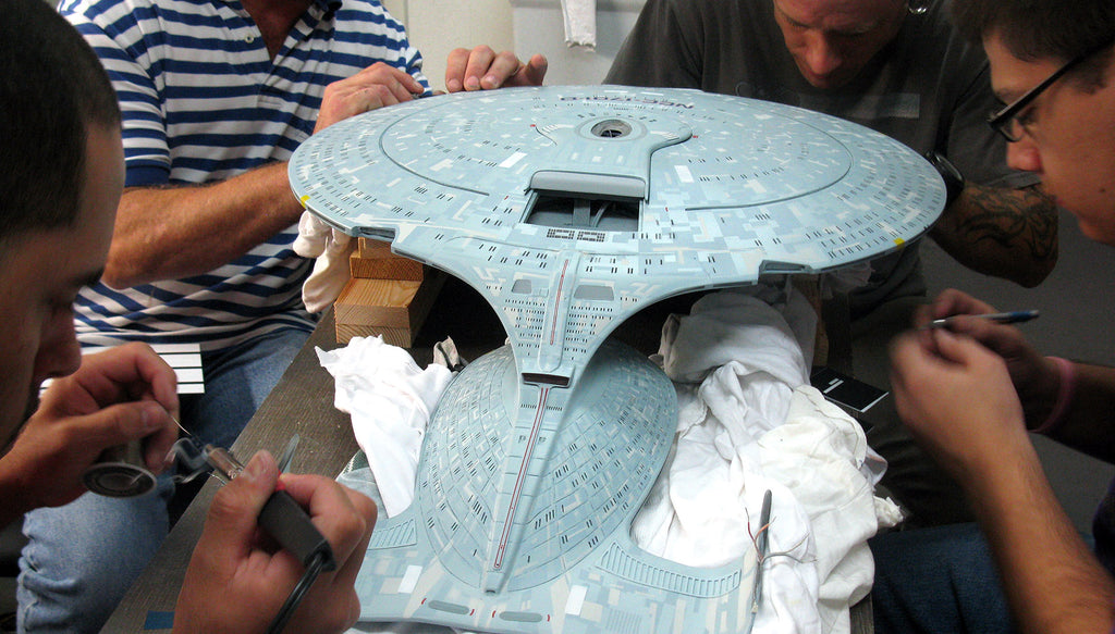 QMx FX Cinema Arts artisans work on an Enterprise D replica