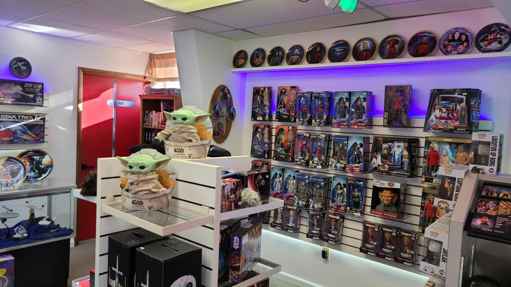 A wall covered in various collectibles from Star Wars.