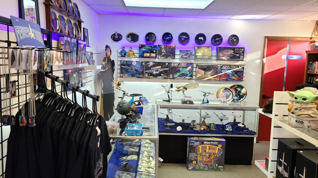 A wall showcasing various Star Trek collectibles.