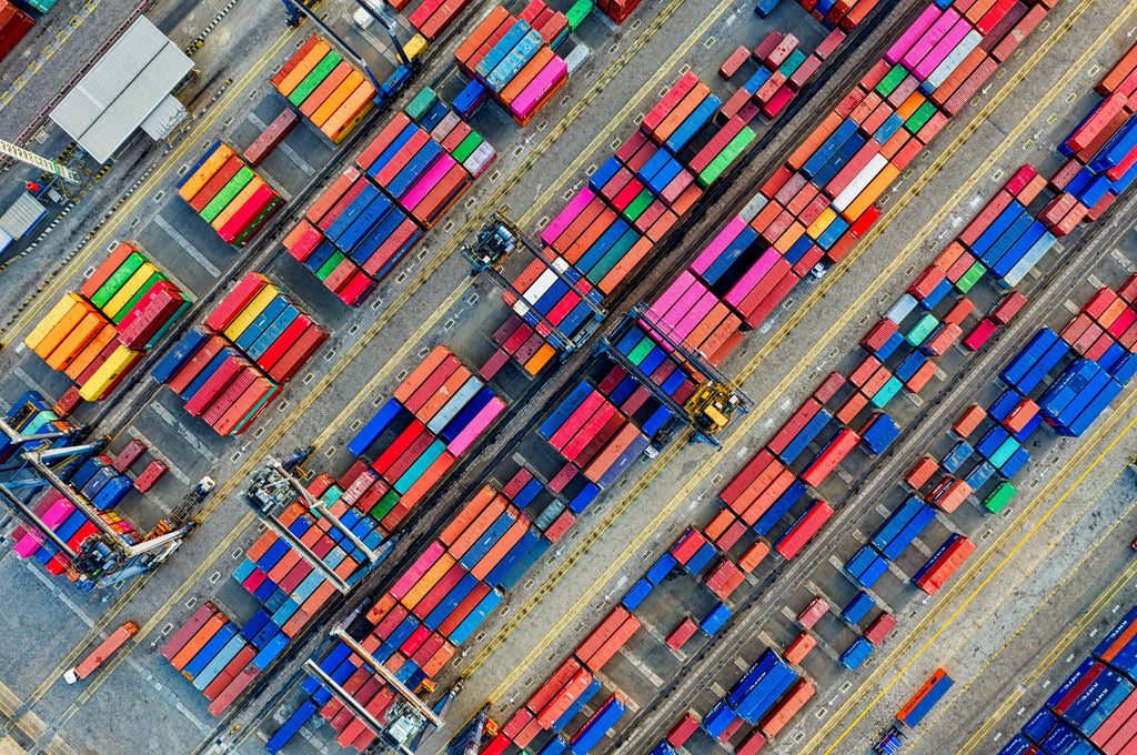 An overhead view of shipping containers at port.