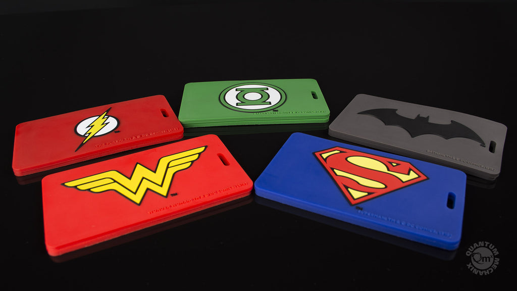 Clockwise from top left: Flash, Green Lantern, Batman, Superman & Wonder Woman Q-Tags.