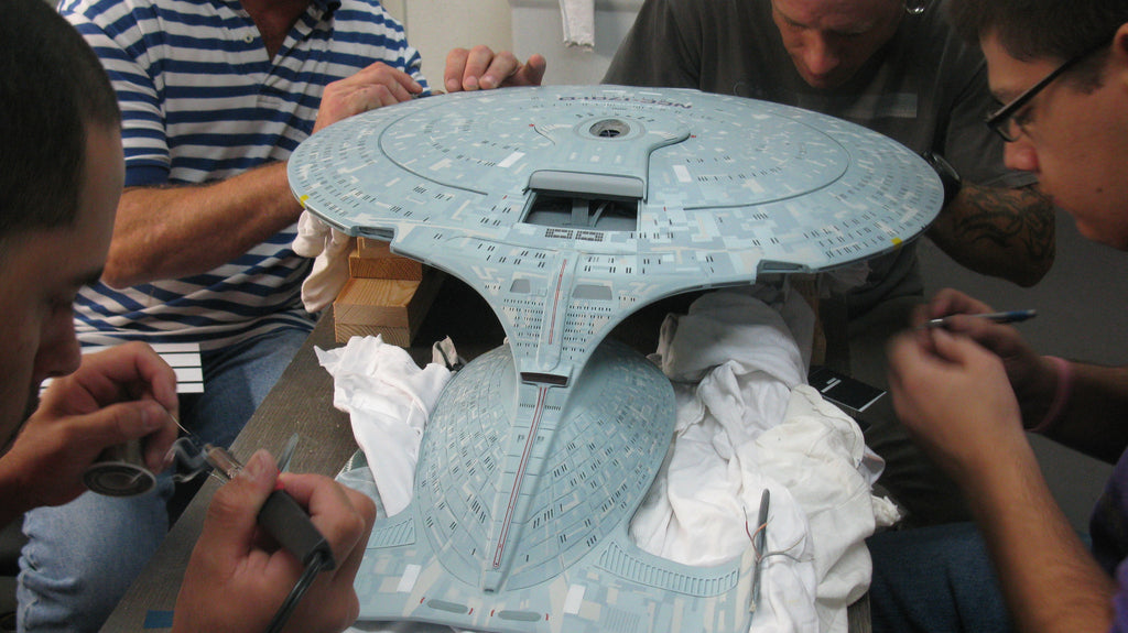The Cinema Arts team gathers around the Enterprise D to work on its finer details.