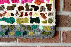 Hand hooked mini wool rug by Locals artist Charlie Dalton