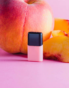 peach pod with peaches pink background