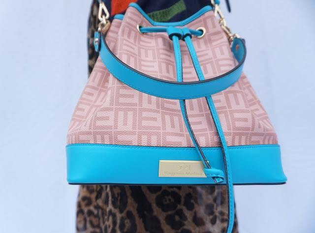 Designer teal leather bag. new season designer leather bucket bag in teal and nude. Designer smooth leather bucket bag.