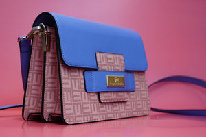 a must have leather handbag.  crossbody bag for women. Designer leather bag in blue.