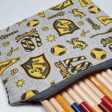 Load image into Gallery viewer, Hufflepuff Emblems Zipper Pouch Close Up