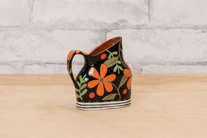 Load image into Gallery viewer, A ceramic creamer by artist Nancy Gardner.