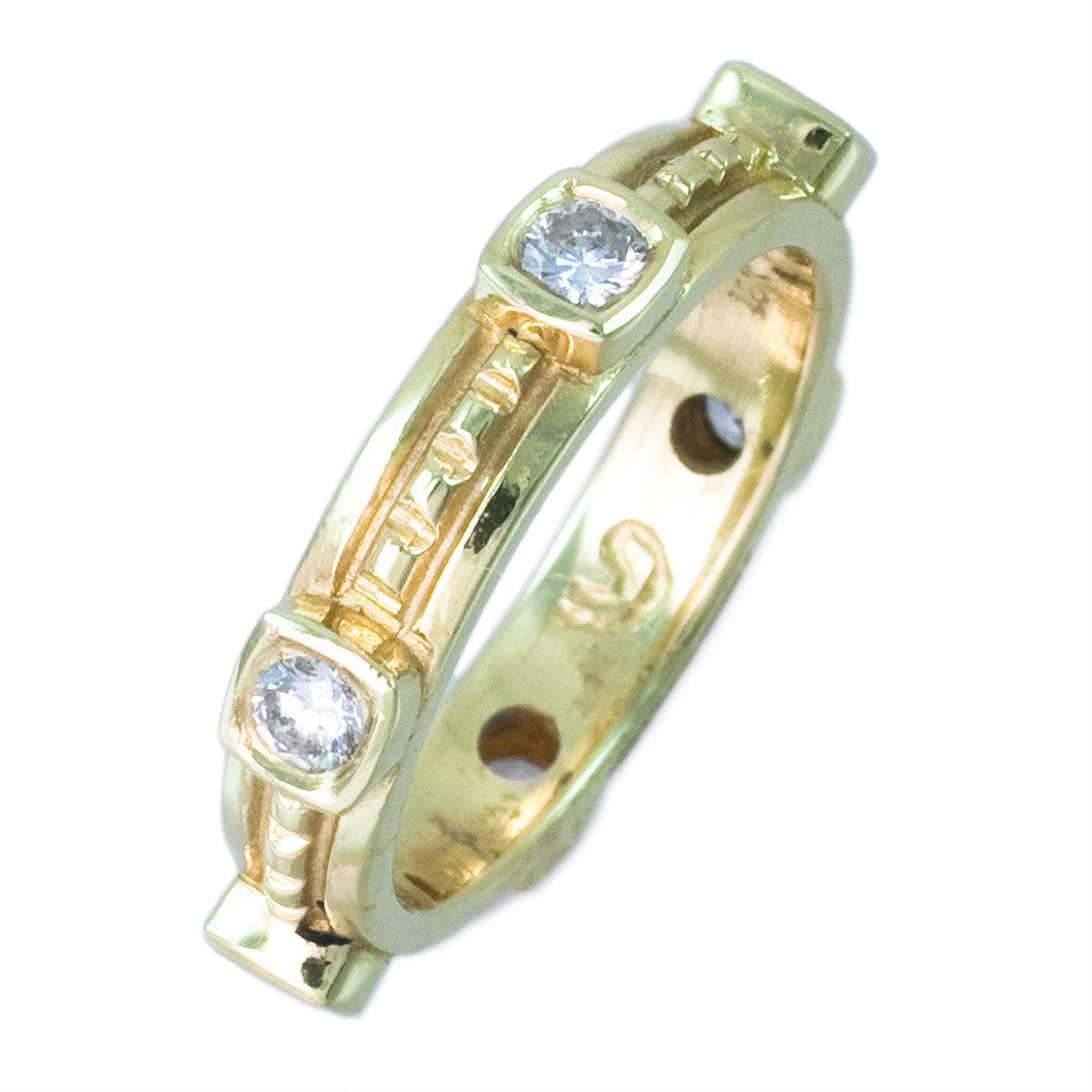 <b> 18 KARAT YELLOW GOLD AND DIAMOND BEZEL SET BAND</b><br>by G.S. DESIGN