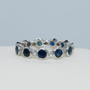 14K WHITE GOLD BEZEL SET SAPPHIRE AND DIAMOND ETERNITY BAND - PERSONA JEWELRY