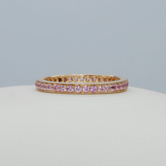 18K ROSE GOLD COMMON PRONG SET WITH MILGRAIN EDGE PINK SAPPHIRE ETERNITY BAND - PERSONA JEWELRY