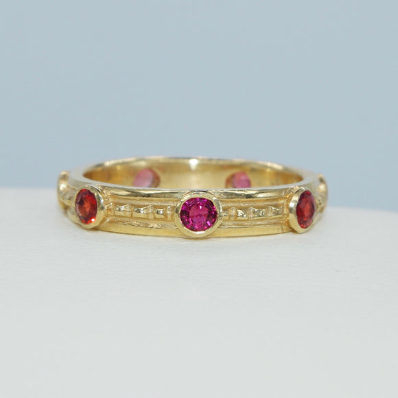 18K YELLOW GOLD 7-STONE ROUND BEZEL SET CRIMSON SAPPHIRE ETERNITY BAND - PERSONA JEWELRY