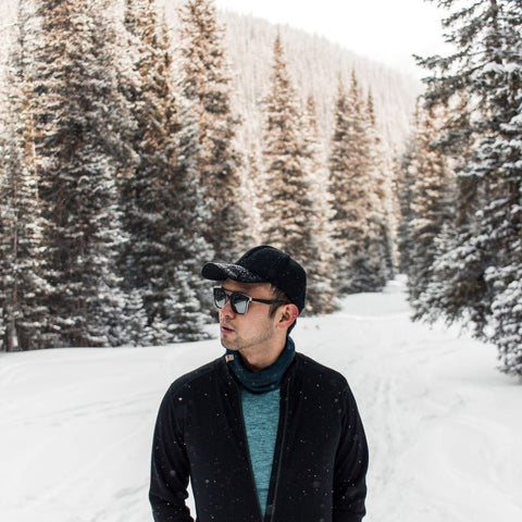 Khai on a snowy trail wearing Wilderness Expedition Full Zip