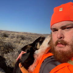 Forrest pheasant hunting with his dog River