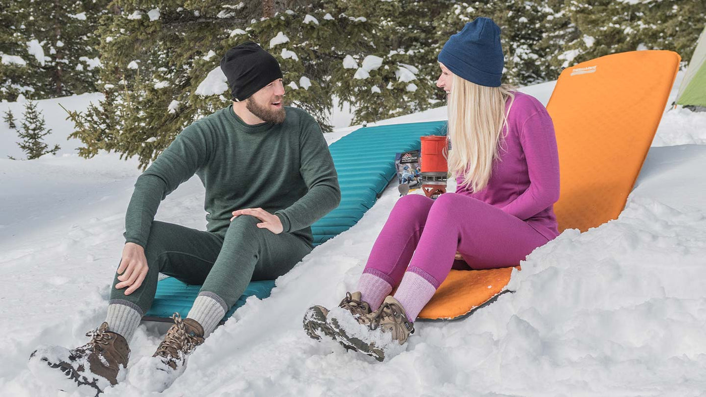 Couple Wearing Minus33 Midweight Merino Wool Base Layer Outfits