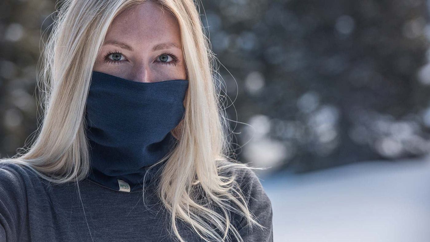 girl wearing minus33 merino wool midweight neck gaiter face mask