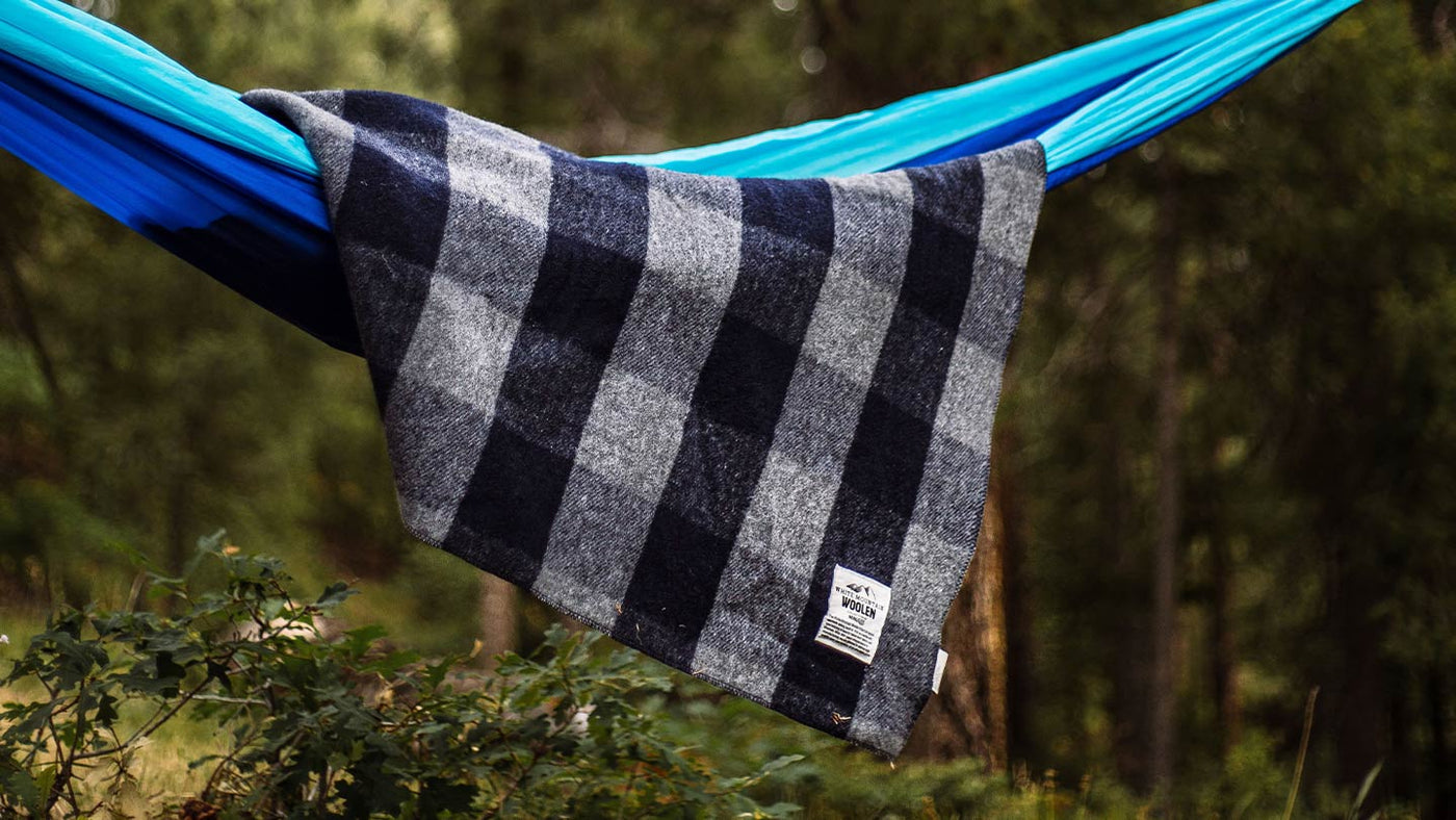 wool throw blanket in plaid on a camping hammock