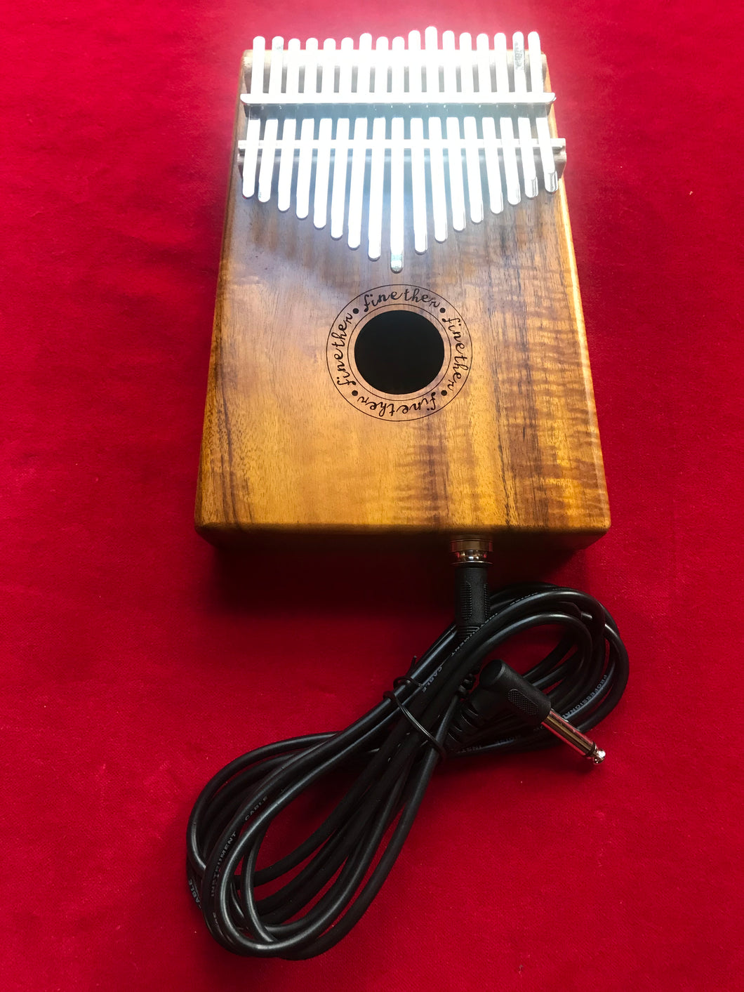 Electric kalimba with cable and bag