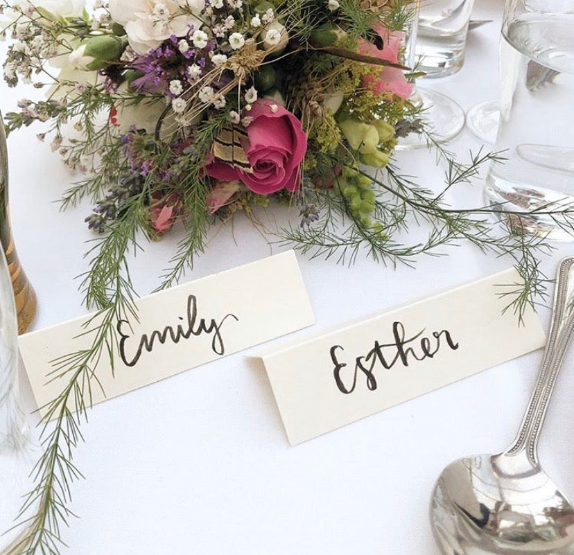 Names on a table at a wedding