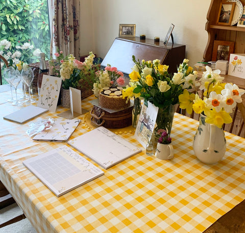 Dining table with flowers all over and yellow table cloth