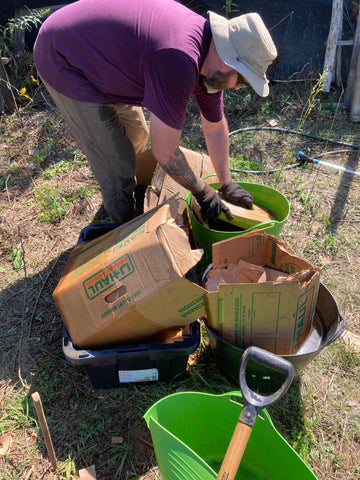 Adding moisture to the compost to help get things started.