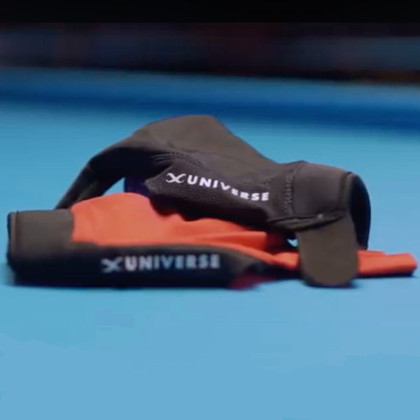Two gloves stacked on billiards table