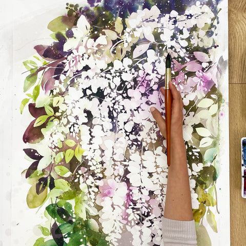 White wisteria watercolor painting with bright green leaves and a purple wisteria background. Original art by artist Ingrid Sanchez, AKA CreativeIngrid. London 2021.