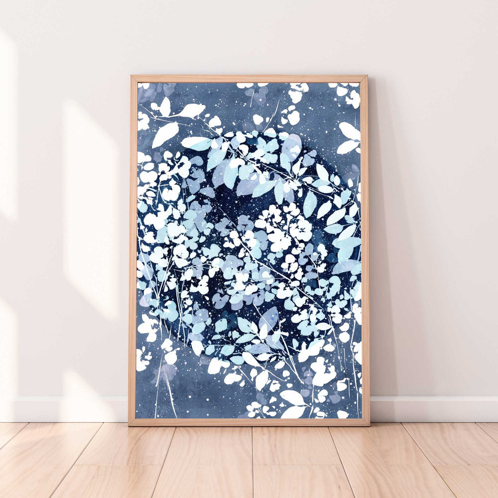 Art print of an indigo blue night with a New Moon camouflaged with white flowers and snow. Artwork inspired by the Snow Moon of February. Home decor by CreativeIngrid.