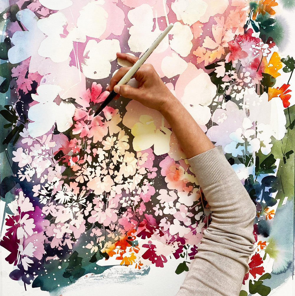 Watercolor artist Ingrid Sanchez painting a colorful garden of flowers in pink, burgundy, purple and orange falling into the dusk. 'Pink Dusk Garden', London 2021.