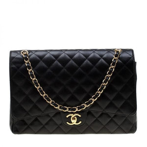 The Chanel Black Quilted Leather Maxi Classic Double Flap Bag