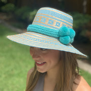 Shown with light turquoise pom pom hat band.
