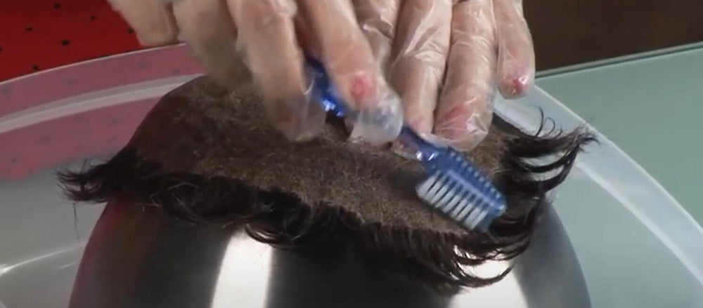 scraping off the adhesive residue