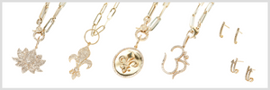 A collection of 14k gold and diamond necklaces and stud earrings