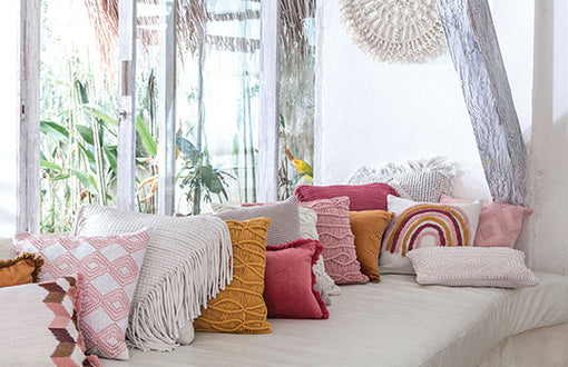 USING COLOURED CUSHIONS TO BRIGHTEN YOUR HOME