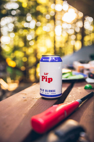 "Photo of a can of ""Lil' Pip"" beer. This is the name of our Wild Blonde Ale."
